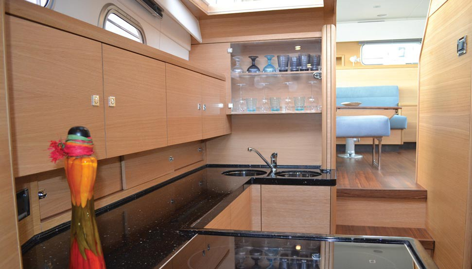 A 42 galley in American white oak, with custom stowages and an induction hob
