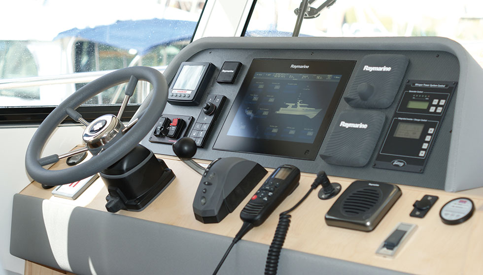 "Command station with all equipment to hand. This 40DS has an Empirbus digital switching system, allowing all electrical functions to be controlled via the 12"" Raymarine touch screen"