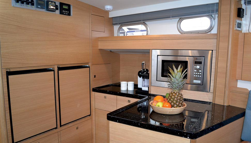 This 42's open-plan galley arrangement gives lots of space for fridge, freezer, microwave, and a dish washer under the high-gloss Corian countertop.