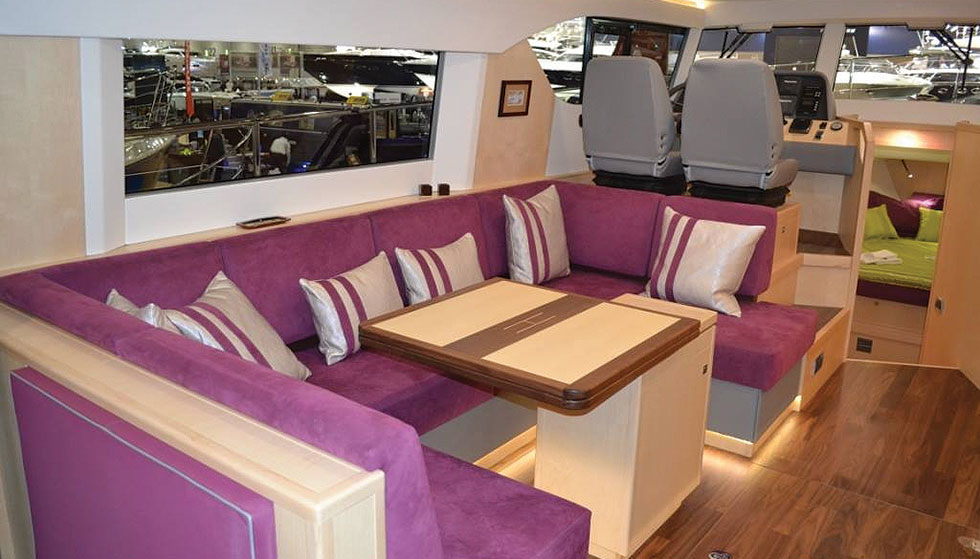 Joinery in maple with contrasting walnut accents and floor and LED mood lighting, both in the settee kick recess and headliner